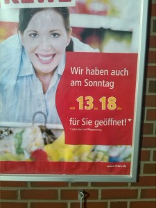 """loosely translated into English: """"Buy your beer here on Sundays"""""""
