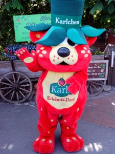 """Karlchen, the friendly """"strawbeary"""" at the entrance/exit of Karl's"""