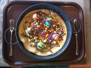 """Pancake """"Kackfidel & Poppenlustig"""" with marshmallows, melted chocolate, and chocolate beans"""